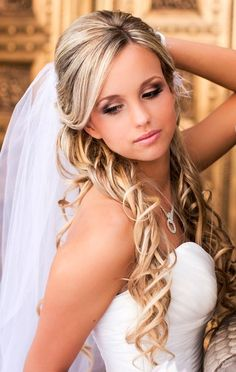 Bride's side part, half updo long curls with under veil wedding hair