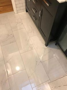 Home Decorators Collection Carrara 12 in. x 24 in. Polished Porcelain Floor and Wall Tile sq. / – The Home Depot, - Bathroom Flooring Vinyl Flooring Bathroom, Marble Bathroom Floor, Bathroom Vinyl, Kitchen Flooring, Bathroom Interior, Modern Bathroom, Marble Look Tile, Bathroom Ideas, Home Depot Bathroom Tile