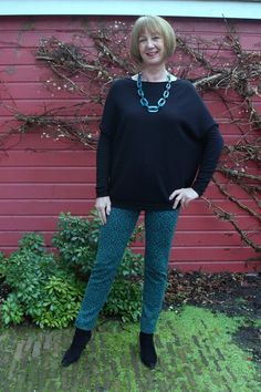 Max Mara skinnies with big black sweater and teal necklace