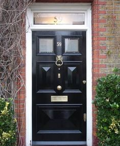 LOve love the glossy black door with the gold hardware