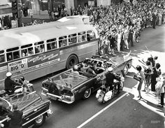 "President Kennedy on that dark yet sunny day in Dallas 50 years ago, minutes before he was assassinated. November 22, 1963. ""Overview of crowds of people waving as President John F. Kennedy and his wife sit in back of limousine during procession through downtown Dallas, Texas; Texas Governor John Connally and his wife ride in the limousine's jump seats."