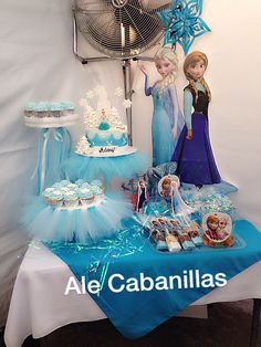 Frozen birthday party. Dessert table with Anna and Elsa, I love the tutus on the cake stands. So cute!!