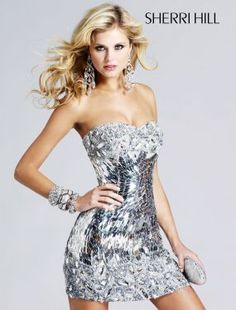 A great Shinny dress! It would make a great outfit for a summer wedding or engagement.  I am Loving the matching accessories as well.