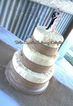 This three tiered buttercream hessian / burlap and twine cake lends itself to many designs. This one was finished with bright purple and teal gerbera gumpaste flowers, but it would also look beautiful in pastels or even fresh flowers. Cakes from Bella Capella Culinary Delights in Capella, Queensland's Central Highlands, Australia. Contact: bellacapella@bigpond.com https://www.facebook.com/BellaCapellaCulinaryDelights