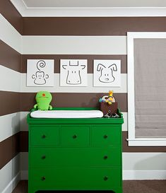 Dress up your room with a pop of color. #nursery    Love bright painted furniture and these neutral striped walls are tres chic!!!