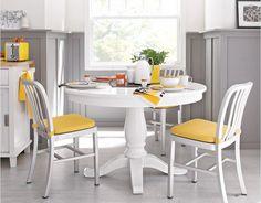 Gray wainscoting in white/yellow kitchen