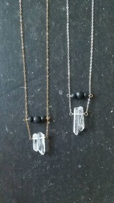 Essential oil diffuser necklace featuring a pair of mini raw quartz crystals and lava rock beads on which to diffuse your favorite essential oil.
