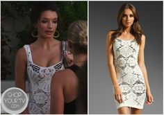 Madz (Alice Greczyn) wears this white body con lace overlay dress in this week's episode of The Lying Game.