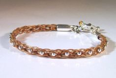 Rectangular braid horsehair bracelet with sterling silver bead and citrine cabochons in the toggle clasp bar ends.