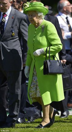 Escort: The Queen arrives at the ceremony at Bayeux alongside military officials from both...