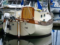 """Falmouth Cutter 22 - Another view of the stern of """"Sookie,"""" apparently named """"THE"""" at this point. Beautiful boat from any angle, the Falmouth Cutter 22 has some of the nicest lines of any sailboat."""