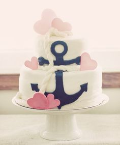 Darling {Navy & Pink} Sweet Sailor Birthday Party with nautical details like pink anchors, navy striped pinwheels & starfish decorations.