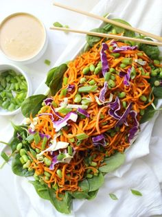 This Sweet Potato Noodle Salad with Peanut Dressing combines fresh spinach, cabbage and green onion with sautéed sweet potato noodles and shelled edamame.