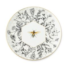 Equal parts elegant and eye-catching, our porcelain salad plates showcase a bee and wildflowers on a backdrop of honeycomb. Detailed with gold, the collection layers beautifully with white porcelain dinnerware and serveware to create a welcomi… Honeycomb Cake, Appetizer Plates, Dinner Plates, Class Design, Nordic Ware, Porcelain Dinnerware, Christian Lacroix, Salad Plates, Queen Bees