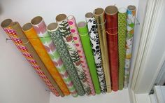 """So easy to store wrapping paper rollers using that """"nothing"""" space in your closet."""