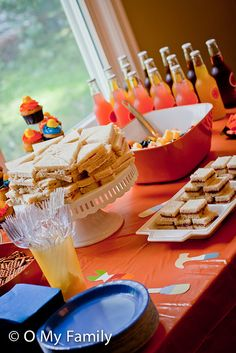 "Food ideas for toddler party: We served finger sandwiches (ham & cheese, chicken salad, and ""sunflower butter"" & jelly – two kiddos in attendance had peanut allergies), fruit salad, a veggie tray, pretzels, Izze sodas, water, juice, and cupcakes."