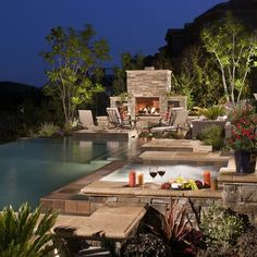 Night view of an awesome negative edge pool in the mountains.