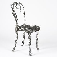 Engineering Temporality by Finland's Tuomas Markunpoika Tolvanen. He coveres pieces of furniture in a fine web of steel rings before destroying them with fire to make functioning objects that resemble fuzzy fading memories of the originals.