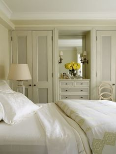 creamy color scheme and built-ins with luxurious linens ~ Christopher Maya design