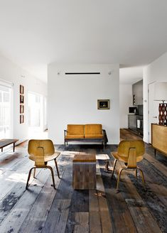 Symphony in wood - Love the floors, lamp on the right, furniture, and general spare feel.  Would love to add a big painting on the back wall, and arrange the seating for a more intimate conversational feel... ~TAB