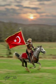 Turkish rider holding the turkish flag on his hand