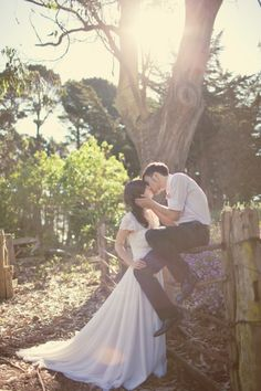 love it all: the couple, the dress, the lighting! *content sigh*