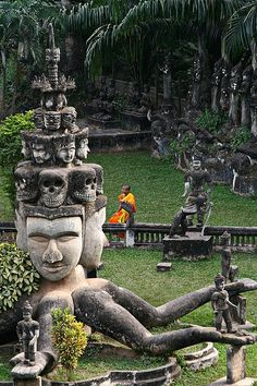 Buddha Park, Vientiane, Laos. Smokin hot, love the skulls!