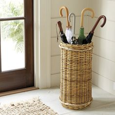 Warm natural texture and welcome storage for the entry or mudroom. This Wicker Umbrella Stand is tightly hand woven of natural rattan. A removable stainless steel liner catches drips. Entryway Furniture, Wicker Furniture, Entryway Decor, Entryway Ideas, Patio Umbrella Stand, Umbrella Holder, Umbrella Stands, Patio Umbrellas, Ideas Prácticas