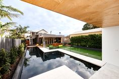 A New Poolside Lounge Area Designed For A Family Home In Australia
