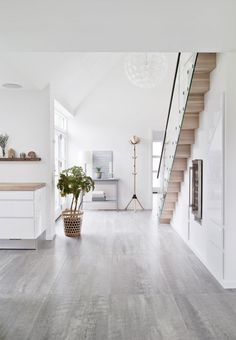 Bright and spacious entryway with scandinavian interior design and wooden details.