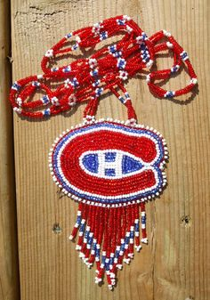 This is a silver pyrite beaded choker with a silver pendant on memory wire. Montreal Canadiens, Native American Beadwork, Beaded Choker, First Nations, 4th Of July Wreath, Nativity, Crochet Earrings, Crochet Patterns, Beading Ideas
