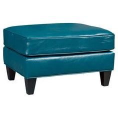 """Upholstered in rich teal-hued leather, this classic ottoman brings a luxe touch to your living room or den.   Product: OttomanConstruction Material: Wood and premium leatherColor: TealFeatures:  Made in the USATapered legs Dimensions: 17.5"""" H x 27.5"""" W x 20.5"""" D"""