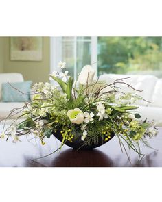 """{$tab:description} Impressive decorating is easy The crisp whites and greens of spring blooms bring a burst of permanent freshness into your home or office. White tulips, lilacs, dogwood, with green berries and viburnum, coalesce beautifully in a 9"""" oval, black ceramic planter. A low profile silk flower centerpiece designed with fresh, monochromatic appeal, for your table, and year-round enjoyment.{$tab:DETAILS} 14"""" Height x 26"""" Width Black Ceramic Oval Bowl - 4""""H x 7&qu..."""