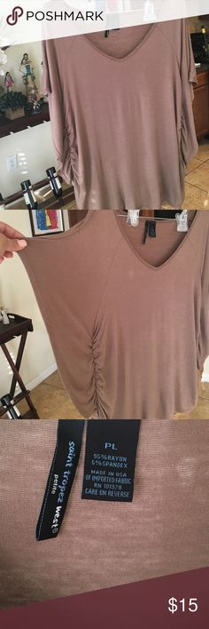 Tan blouse Casual tan, V-neck blouse. Sleeves fan out. And can be adjusted with a tie at the bottom of the shirt. Great casual blouse Tops Tees - Short Sleeve