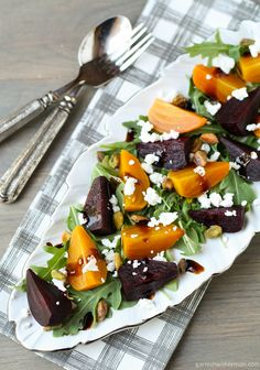 Roasted Beet and Arugula Salad with Pistachios and Goat Cheese- Garnish with Lemon