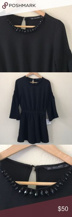 """NWT Zara Romper Jewel Neck Bell Sleeve  sz XS Brand: NWT Zara   Color: Black  Style: Gorgeous jewel scoop neck Romper (jumpsuit with shorts). Cute bell 3/4 sleeves with pin tuck accents.m. Side zip. Open key hole back. Perfect for date night or dancing! Absolute statement piece!   Materials: Polyester  Size: XS  Bust: 17"""" Waist: 12.5"""" Length: 33"""" Shorts rise: 14""""  🍍🍍🍍NWT. New with Tags. Bundle & Save with my Other Listings! Zara Pants Jumpsuits & Rompers"""