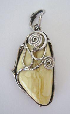Vintage Baltic EGG YOLK AMBER Pendant Brutalist Handwrought 925 Sterling Silver by VintageFunkandFlair on Etsy https://www.etsy.com/listing/200265712/vintage-baltic-egg-yolk-amber-pendant