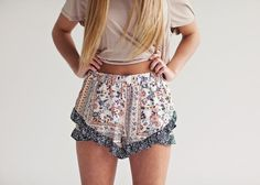Cream base color Floral print Elastic waist band Ruffle detail Model is wearing a small Paired with our Cut It Out Top