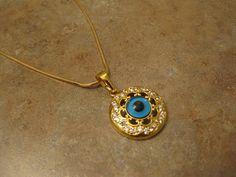 Evil Eye Jewelry  Evil Eye Necklace Gold Evil Eye  Evil Eye Pendant Turkish eye Turkish Evil Eye Gold jewelry. $60.00, via Etsy.