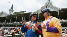 Cheering on the jockeys in traditional style cigar and julep