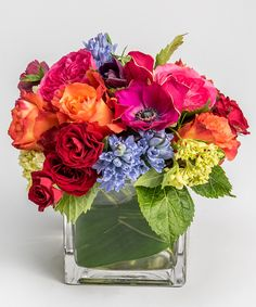 berry colored garden roses, hyacinth and anemones