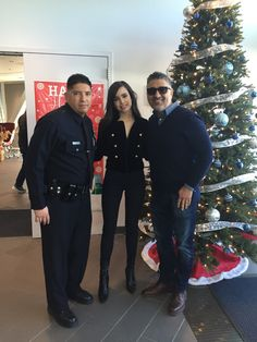 Pizza, Police, Toys & Santa Claus! Visit our blog to learn more about this special day dedicated to the children of Los Angeles!  Pictured: Juan Padilla (LAPD Officer), Sofia Carson (Actress), Aro Agakhanyan (BMPP Founder)