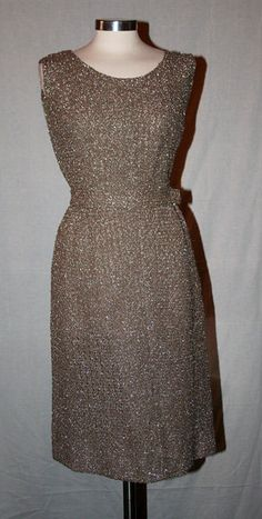 Laminated silver and gold dress. Designed by Christian Dior.