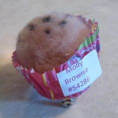 The cupcake swap is made with a pompom glued into a mini cupcake cup and embelished with marker.