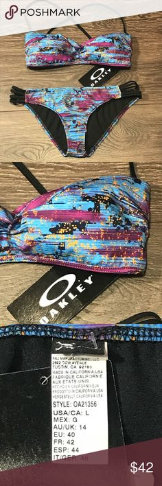 "Oakley 2 Piece Swim Suit Oakley Swimsuit Women's bottom and top are size Large Padded bandeau top with removable straps back hook, style no. OA21106 Bikini bottom, style no. OA21356 Measurements taken laying flat and unstretched 16"" waist 14"" across bandeau top **Small defect on loop where hook from removable strap hooks into on right side of bandeau top is damaged, it could easily be sewn or if the straps aren't going to be used, it would not be an issue.  I have marked the  place in my…"