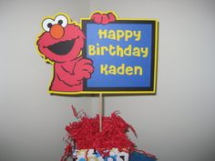 Elmo Happy Birthday sign personalized with your childs name.     The sign is 7 high x 10 wide. This is single sided and there is a solid backing so