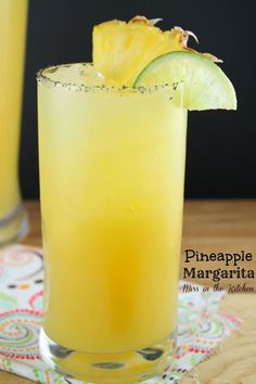 Pineapple Margaritas - makes 2 quarts 3 cups pineapple juice 1 3/4 cuporange juice 2 oz fresh lime juice 1 cup triple sec 1 cup tequila icesalt for rim of glass fresh pineapple and lime slices for garnish