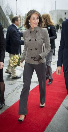 Princess Marie looking elegant in long dark grey trousers and a light grey tweed jacket with a double-breasted front, as she arrives for the summit.