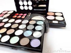Make-up colorful eyeshadow palettes  on white background