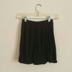 BM skirt LIKE-NEW Black Brandy Melville skirt. Super soft fabric that is suede-like. Worn once. About 14 inches long Brandy Melville Skirts Mini